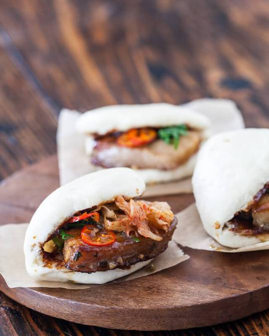 Jaden from A Steamy Kitchen shows off her delicious Pork Belly buns .